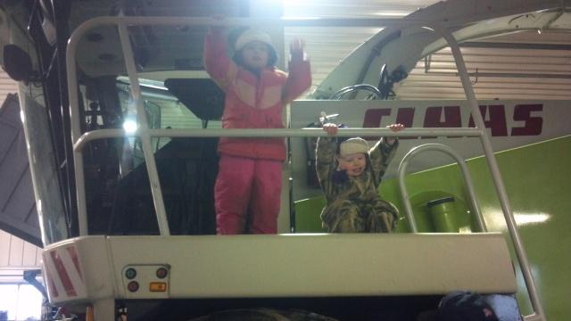 cute kids on claas chopper