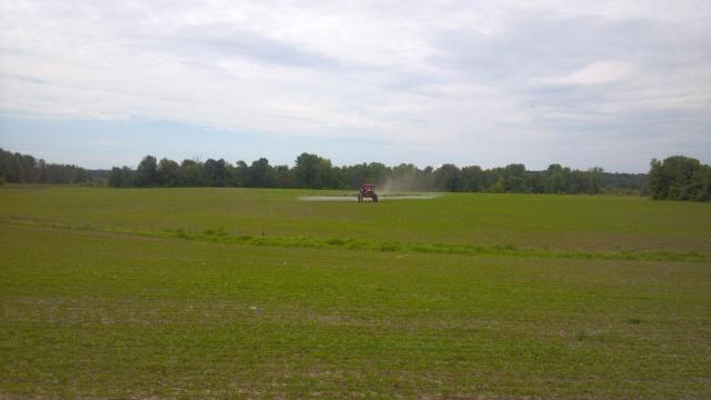 apache sprayer spraying soybeans
