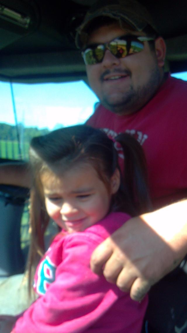 cute little farm girl in haybine