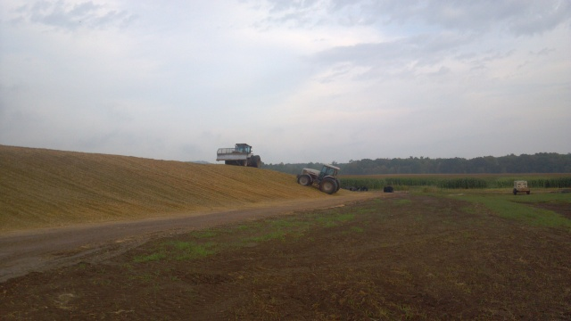 two white 6215 on silage pile