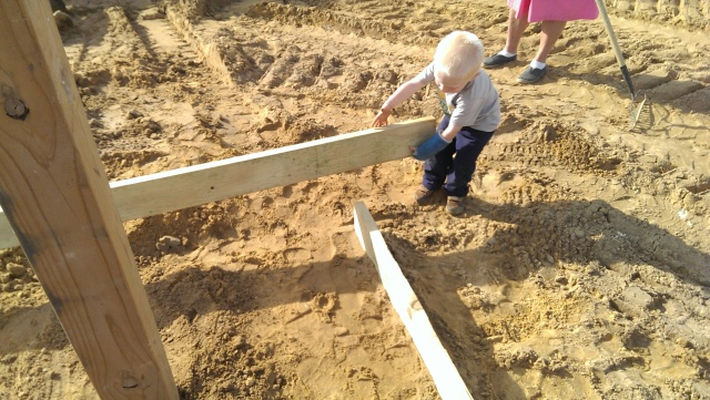 cute farm boy setting concrete forms
