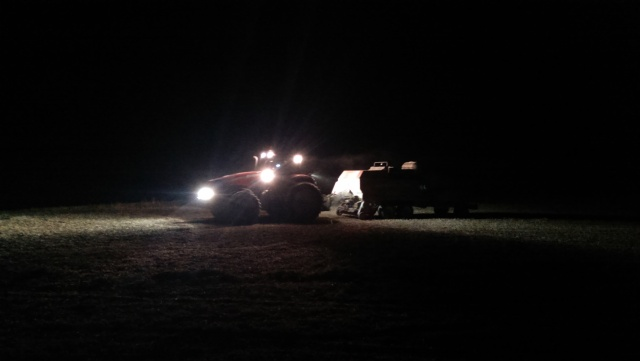 case tractor baling at night