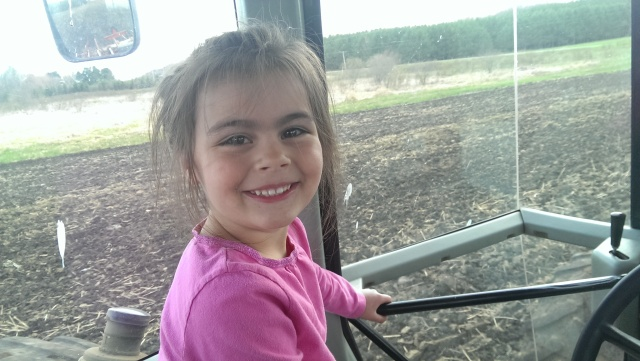 cute farm kid in tractor