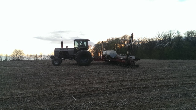 corn planting at sun set