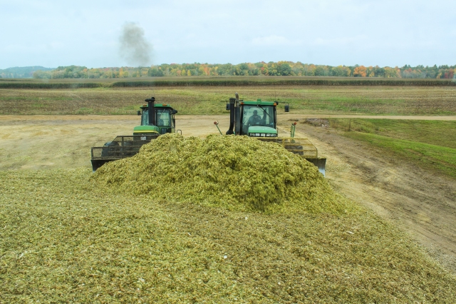 john deere pushing silage