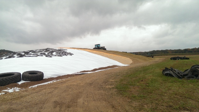 covering drive over corn silage pile